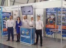 """Сотрудники Good Light около стенда на строительном форуме-выставке """"Expo Build Russia"""""""